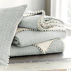 Layer on the fun with our playful gray Audree Pom Pom Quilt. Designed to blend with lots of our best-selling bedding collections. Shop Ballard Designs.