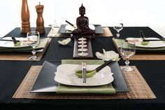 Now and Zen – BARB AND BEAR This is a beautiful full place setting complete with 4 Bamboo Placemats, 4 Black Square Chargers, 4 Green Dinner Napkins, 4 Wontoon Spoon Chopstick Rests, 4 Pairs of Chopsticks, a Five Tea Light Candle Holder and 1 Buddha Statue Centerpiece.