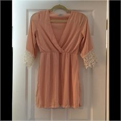 Chiffon like mini dress with sleeves - NWOT Blush/nude color, v neck, gathered waist, long sleeves with cream colored lace trim, lined, 100% polyester-----Never Worn Tobi Dresses Mini