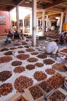 date vendor at the market in Rissani, Morocco