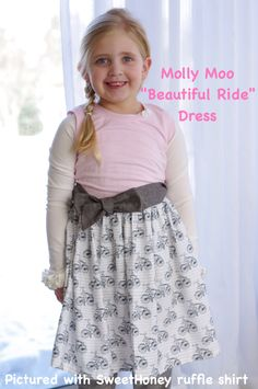Super cute  Molly Moo Bicycle dress!  Styled with Sweet Honey ruffled ivory layering shirt  https://www.facebook.com/mollymoobowtique