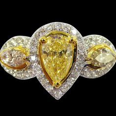 This ring designed with 3 stunning yellow diamonds is simply gorgeous. I'd # PRO440-P882 for price, emails us at sales@solitairejewels.com