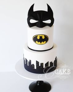 BATMAN wedding cake! Pretty much one of the coolest wedding cakes I've been asked to make. Batman mask is handmade from fondant. Vanilla with salted caramel buttercream on the inside. #weddingcake #cake #cindyscakecreations