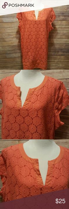 Plus size blouse/tunic I wear it as a long top, almost a tunic. Orange crochet like overlay on top of fully lined shell.  Short sleeves. Measures approx 27 bust and 33 length. Peachy orange color.  Size 2x Isaac Mizrahi Tops