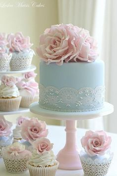 Love the idea of a smaller wedding cake accompanied by cupcakes