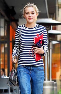 Kiernan Shipka in a Commes Des Garçons Play striped t-shirt, blue jeans, and a silver bag