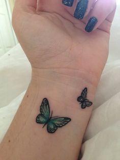 Beautiful Green Butterfly Tattoos On Left Wrist