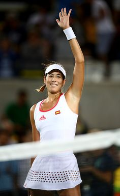 Garbine Muguruza of Spain celebrates victory over Andreea Mitu of Romania in their singles match on Day 2 of the Rio 2016 Olympic…