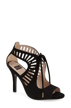 Curvaceous cutouts heighten the modern dramaof this lace-up suedesandal that stands out from the crowd.