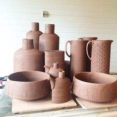 Ok, handles are on the pitchers and I'm stirring the glaze buckets. For real. #gettingdowntobusiness #jugs #vases #sake #bowls #flasks