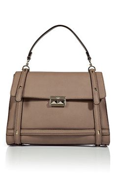 VALENTINO  Pale Mauve Rock Stud Bag  $1680 sale price  The ultimate investment piece, this Valentino purse boasts a classic shape with modernized styling  Top carrying handle, front flap, gold-tone hardware and front stud detail