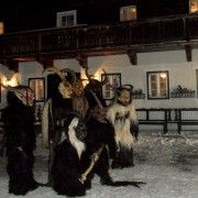 KRAMPUS NACHT (KRAMPUS NIGHT) -  In Southern Bavaria, local folks celebrate St. Nicholas Night in an alternative fashion. Muscular men wearing in demonic costumes, devilish masks and furry coats march from house to house, banging against doors and, when invited in by expecting parents, will frighten kids into good behavior.http://germanfoods.org/german-food-facts/german-christmas-traditions/