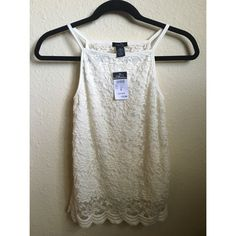 Cream lace tank Brand new tank with tag still attached. There's a layer of fabric under the lace on the front of the shirt and sheer lace on the back. Perfect for summer! Rue 21 Tops Tank Tops