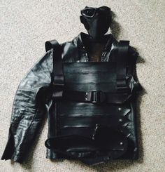 winter soldier cosplay — This just gave me the idea, maybe I can find a basic black leather vest or jacket, and then use black duct tape to create the strappy bits across the front. I could also use duct tape to create holsters for weapons. Duct tape is amazing stuff. -BH