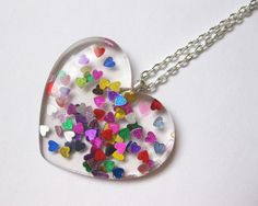 Hey, I found this really awesome Etsy listing at https://www.etsy.com/listing/218272856/pop-kei-rainbow-glitter-heart-necklace