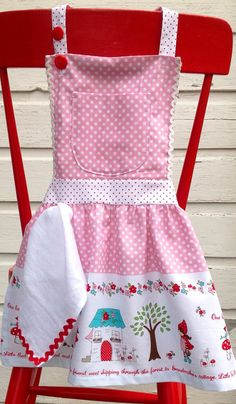 We LOVE aprons! This one is of course practical for when your budding baker wants to help in the kitchen but the gathers and sweet pink polka
