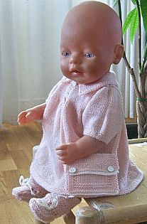 lovely doll knitting clothes in pink and white