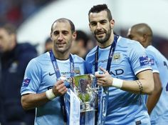Zaba and Negredo with the Capital One Cup