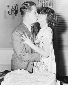 """Jeanette MacDonald and Nelson Eddy share a kiss on the set of """"Sweethearts"""""""