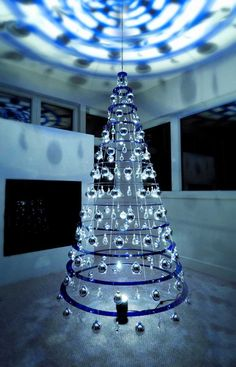 """Originally designed by Lawrence """"Bud"""" Stoecker in the mid the Modern Christmas Tree made from concentric acrylic rings and decorated with chandelier crystals and ornaments, has been brought back to life by his grandson Matthew Bliss. Creative Christmas Trees, Modern Christmas, Holiday Tree, Xmas Tree, Christmas Tree Decorations, Christmas Lights, White Christmas, Christmas Ornaments, Christmas Events"""