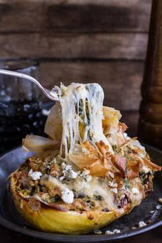 Looking for a healthier carb friendly pasta dish? Check out these cheesy and delicious Spanakopita Stuffed Spaghetti Squash Bowls from halfbakedharvest.com