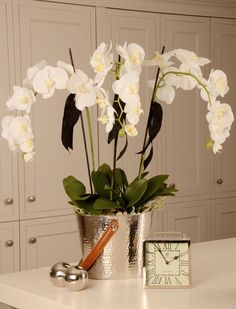 Orchids in Wine Bucket Artificial Silk Flowers Orchid Flower Arrangements, Orchid Centerpieces, Flower Vases, Artificial Silk Flowers, Fake Flowers, Bathroom Decor Pictures, Dining Room Centerpiece, Orchid Pot, White Orchids