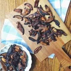 (From Isa/PPK, the GENIUS) SHIITAKE BACON: Toss 4c (~8oz) sliced shiitake caps w/1 TB tamari, 1 TB olive oil, 1 tsp liquid smoke, 1/2 tsp garlic powder, 1/8 tsp salt. Preheat oven 400F, let shrooms soak in the flavor in the meantime. Spread/single layer on non-stick baking pan (dark-bottomed for crispiest results), bake 20-25 min, flipping once. Edges should be nice & crispy. Let cool on baking sheet.