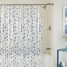 It's raining, it's pouring, but there will be zero snoring with this splashy raindrop shower curtain. Look closely and see a different geometric pattern in each drop.