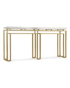 Handcrafted console. Stainless steel frame with gold-leaf finish. Natural stone top; variances in color, pattern, and/or striations are natural characteristics of the stone. No two consoles are exactl