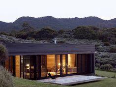Casa de madeira com iluminação interna Arquiteto: Fearon Hay Architects Fotógrafo: Patrick Reynolds
