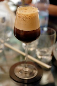 morning martini of freshly made espresso and sugar, vigorously shaken in a martini shaker (or professional mixer) until frothy and presented in a champagne flute or martini glass