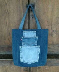 Pick a Pocket Tote Bag. Sturdy yet stylish, this large one-of-a-kind tote bag . Pick a Pocket Tote Bag. Sturdy yet stylish, this large one-of-a-kind tote bag will soon become your trusted compan Denim Tote Bags, Denim Handbags, Denim Purse, Jean Purses, Purses And Bags, Diy Sac, Denim Crafts, Recycled Denim, Fabric Bags