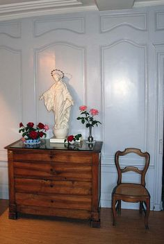 "Our Lady of the Smile    Replica of the statue of the Blessed Virgin Mary (through which St. Therese the Little Flower was cured at age 10) in the bedroom of Therese at ""Les Buissonnets,"" her childhood home in Lisieux, France. The original is placed above the shrine La Châsse du Carmel' at Carmel Chapel."