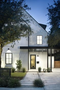 HGTV loves this modern take on a traditional white farmhouse with unique black metal accents, updated landscaping, and a covered entrance with lighting. White Farmhouse Exterior, Modern Exterior, Exterior Design, Cottage Exterior, Modern Barn House, Modern House Design, Modern Architects, Scandinavian Home, Architecture Design