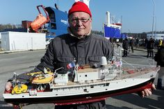 Claude Menu, member of the Cousteau team, poses with a replica of ...