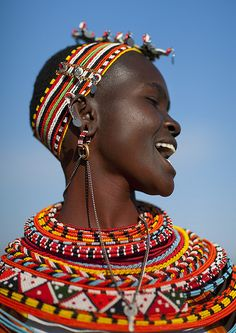 Samburu woman, Kenya. By Eric Lafforgue. Like the Maasai, women wear colorful beaded necklaces. The number of necklaces is a sign of wealth, often given as dowry.