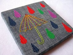 rain and umbrella embroidery.