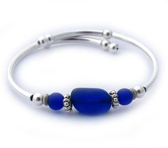 Deep Royal Blue Sea Glass Single Loop Bracelet. Silver plated rounds, and tubes, strung on the same memory wire as our regular sized Embraceling bracelets. Great for an add on, or wear alone for a sim