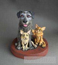 A custom sculpture of a dog and two cats. Positioning can be key to conveying the pets' relationships.