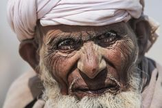 While travelling, found this old man with sand on face in Cholistan Desert - Bahawalpur - Punjab - Pakistan.