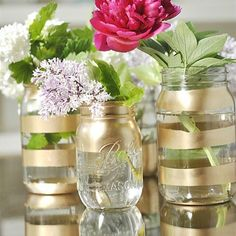 Found these beauties on Pinterest courtesy of @yourhomebasedmom  A simple way to turn a simple dollar store mason jar into a metallic beauty to hold whatever your heart desires #home #homedecor #thegoldenbazaar #gold #sparkle #diy #kitchen #dining #living #budgetfriendly #smallspaces #nyc #toronto #foodie #modern #classic #homegoods #theresnoplacelikehome #interior #apartmentliving #stripes #paint #spraypaint #flowers #vase #pencilholder #cutlery #masonjars by thegoldenbazaar