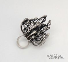 My friend Andrea Hopkins (https://www.facebook.com/TheLovelyOnes?v=info) created this incredible ring from an agapanthus.