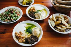 """israel  """"the hummus to end all hummuses, in haifa, with a hardboiled egg and a pool of magic tahini"""""""