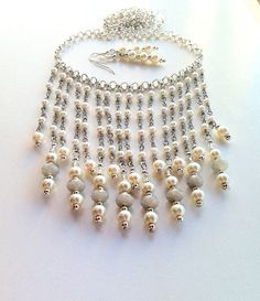 Hey, I found this really awesome Etsy listing at https://www.etsy.com/listing/259086452/pearl-bib-necklace-white-statement