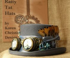 The Quill & Ink, grey and goggled Steampunk lady's hat named after the US mail early 1900s stamp it bears.