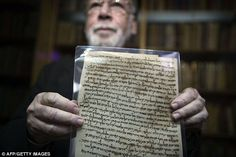 Historic: Haggai Ben-Shammai, academic director of Israel's National Library, displays one of the documents from a collection of discarded religious Jewish writings dated from the 10th century