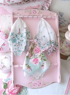 Vintage handkerchiefs displayed in vintage spoon rack