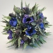 Purple Anemone & Thistle Silk Wedding Bouquet. We love this silk wedding bouquet designed with different shades of purple anemone and thistle or sea holly. Great for a celt themed wedding.