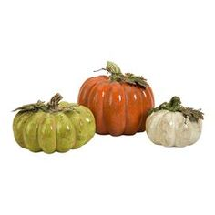 Set of three ceramic pumpkins with twisted vine and leaf accents.   Product: 3 Piece pumpkin dcor setConstruction Material: CeramicColor: Orange, green and creamFeatures:   Adds a charming touch to your mantel, credenza, or side table Twisted vines and leaf accentsWarmly weathered finish Dimensions: 7 H x 8 Diameter (large)