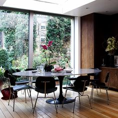 desiretoinspire.net - Eames LCM, @Leah McDonough - Mom would approve of this table - round & enough seating for all of us :)
